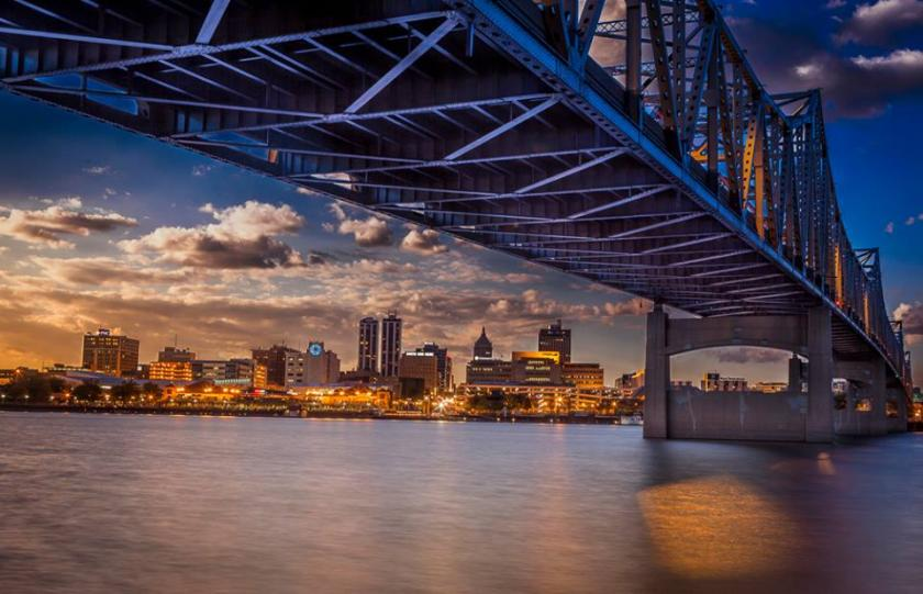 Image of the Peoria, Illinois skyline from under a bridge at sunset